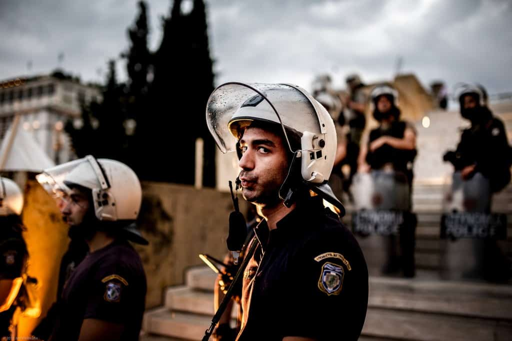 Riot police is fed up by photographing journalists on Syntagma Square, Athens (Copyright Jan Wellmann)