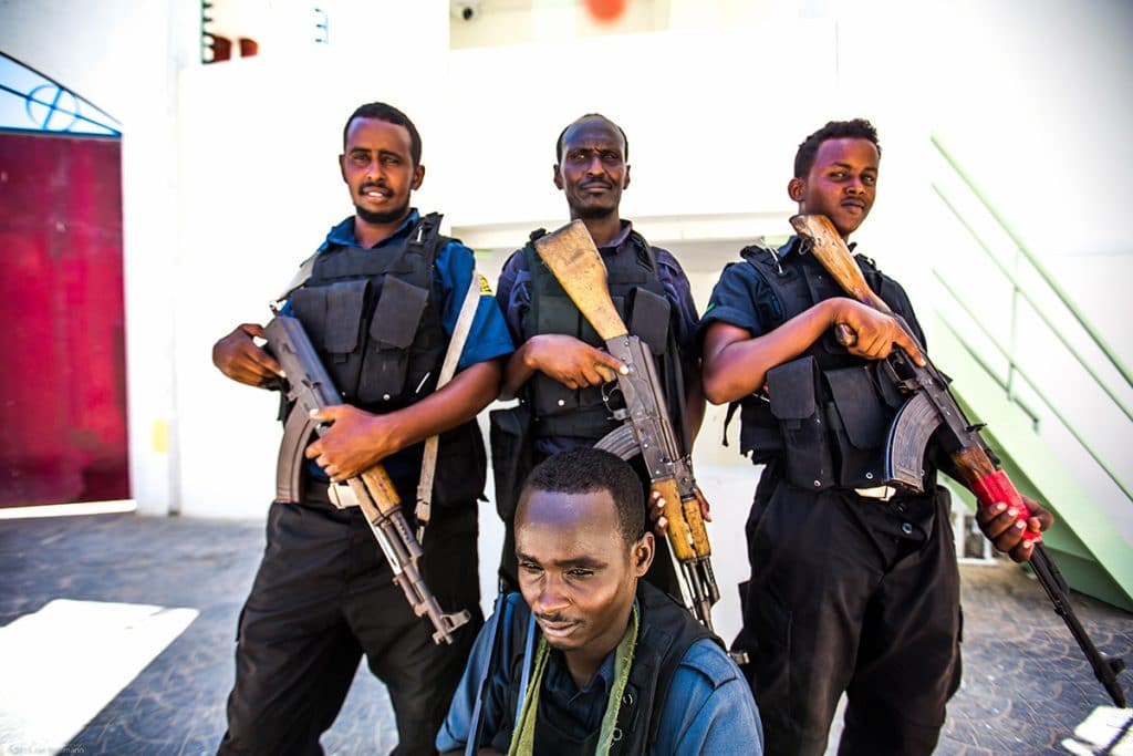 Private guards during a lunch break in Mogadishu